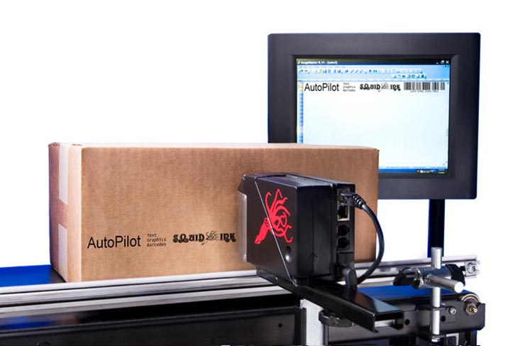 The Squid Ink AutoPilot hi-resolution industrial inkjet printer printing logos and other information on corrugated boxes for product traceability