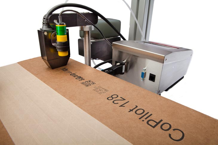 The Squid Ink CoPilot 128 hi-resolution industrial inkjet printer coding and marking in the down shooter position
