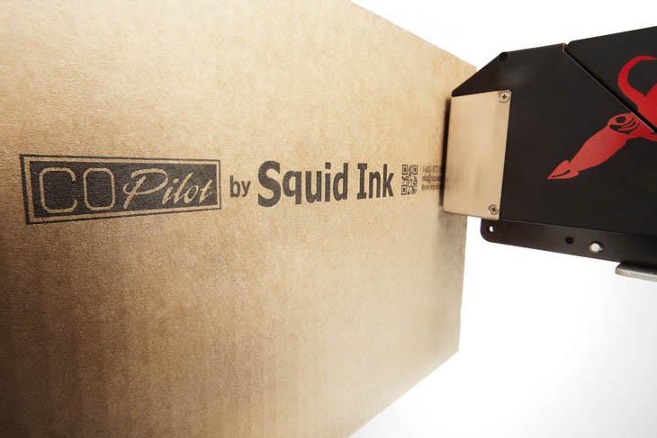 The Squid Ink CoPilot hi-resolution industrial inkjet printer case coding and printing barcodes on a corrugated cardboard box