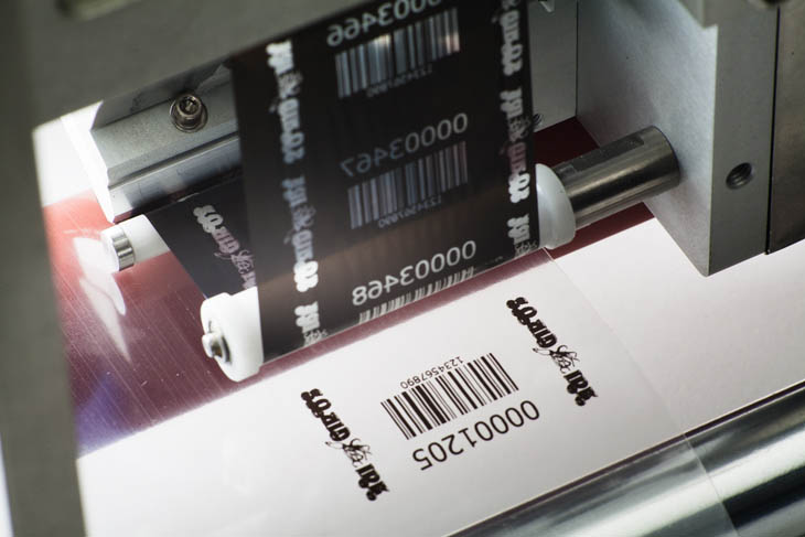 The Squid Ink Thermal Transfer Overprinter TTO printing high quality date codes, barcodes, and logos at 300dpi