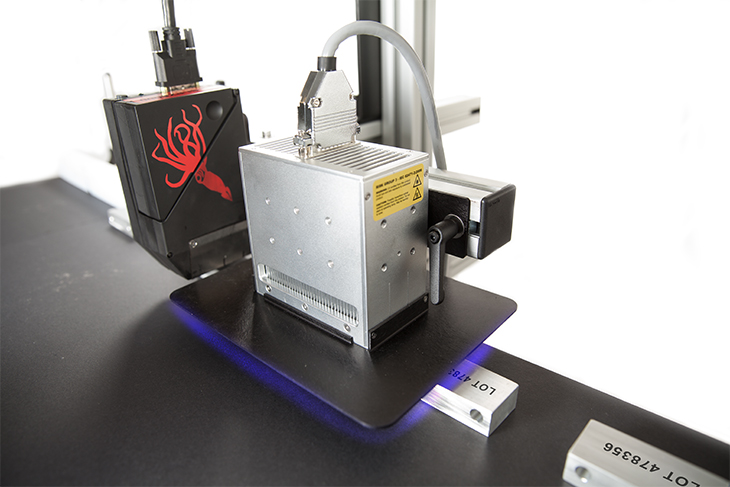 The Squid Ink UV LED Ink Curing System curing uv inks on a metal substrate
